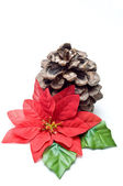 Fake poinsettia with old pine cone — Stock Photo