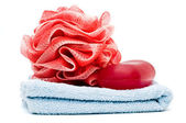 Bath rose and soap bar on top of blue towel — Stock Photo