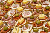 Party appetizers on wooden sticks — Stock Photo