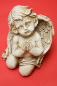 Praying angel looking towards viewer — Stock Photo