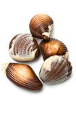 Five chocolate mollusk shaped assortments — Stock Photo