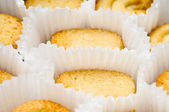 Cookies in muffin cups, angled — Stock Photo