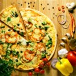 Pizza with vegetables and olive oil fission — Stockfoto