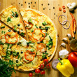 Pizza with vegetables and olive oil fission — Stock fotografie