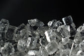 Chunks of ice on a black background photomicrography — Stock Photo