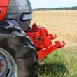 In front of a tractor - Stockfoto