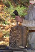 Artisan stonemason of the Middle Ages — Stock Photo