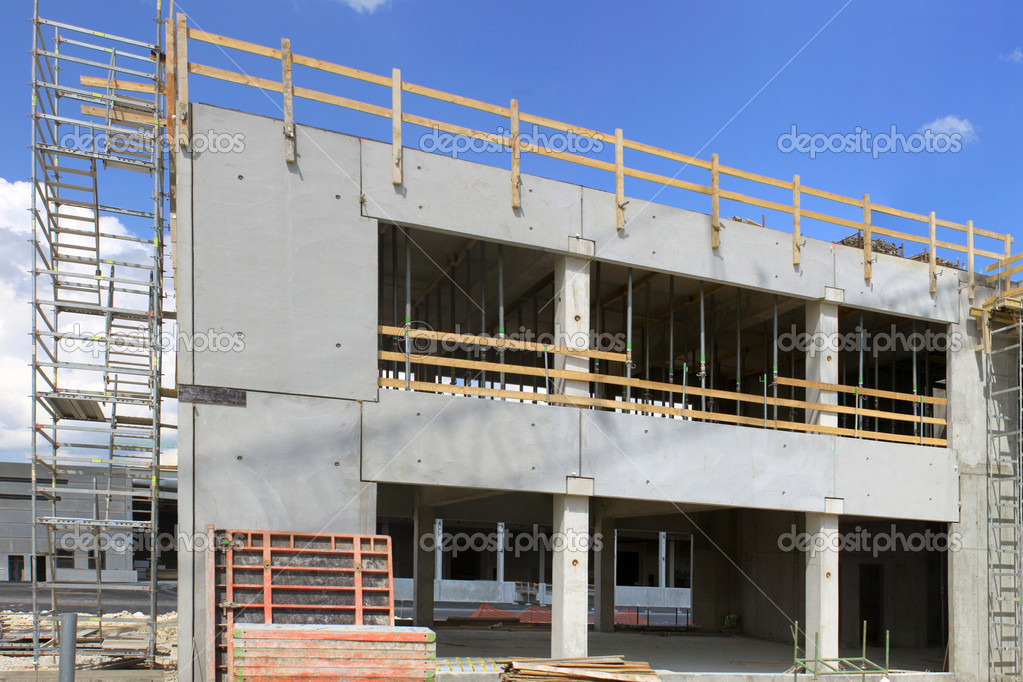Scaffolding on a construction site housing housing estate — Stock Photo #9930276