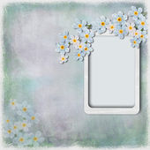 Grunge background with frame and flowers — Stock Photo