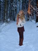 Woman in a snowy forest — Foto de Stock