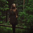 Girl standing in forest — Stock fotografie #9697330
