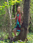 Girl standing in forest — Stock Photo