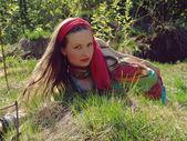 Girl lying in grass — Foto de Stock