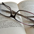 Eyeglasses on the  book - Stok fotoraf