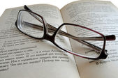 Eyeglasses on the book — 图库照片