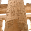 egyptian stone carving on the columns of karnak temple — Stock Photo