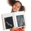 Afro american asian black child with book ultrasound isolated — Stock Photo