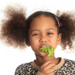 Beautiful child  asian African American Black child eats salad i - Stock Photo