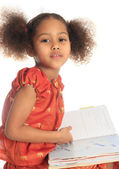 African American Asian black child reads a book isolated metisse — Stock Photo
