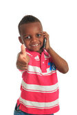 African American child with black telephone isolated — Stock Photo