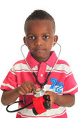 Black African American child with stethoscope and car — Stock Photo