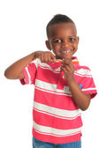 African american black child with a tooth brush isolated — Stock Photo
