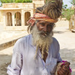 An unidentified holy man at Gadi Sagar Gat - Stock Photo