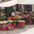 Stock Photo: Unidentified vegetables sellers at market