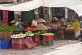 Unidentified vegetables sellers at a market — Stock Photo