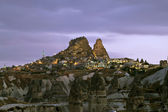 Volcanic landscape and a village in Cappadocia — Stock Photo