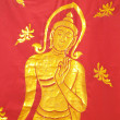 Stock Photo: Buddhon red cloth
