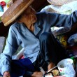 Stock Photo: Bangkok December 2007.old woman's female customers at Damnoen Saduak floating market, Bangkok Thailand