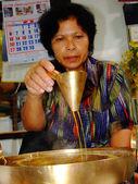 Bangkok May 2008.Thai food Female. Thai desserts are often doing the stare at Ko Kret, Bangkok Thailand — Stock Photo