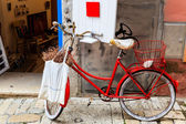 Old Red Bicycle at the Shop Door in Rovinj, Croatia — Stock Photo