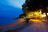 Beach Restaurant near the Sea at Night in Brela, Croatia — Stock Photo