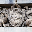 Shield, Helmets and Sword Marble Relief in Genoa, Italy — Stock Photo