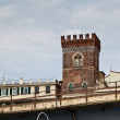 Постер, плакат: Red Defensive Tower in Genoa Italy
