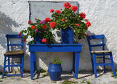 Typical Greek Courtyard with blue flower pots. — Stock Photo