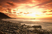 Sunset over rocky coast — Stock Photo