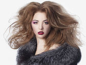 Young girl in a fur coat — Stock Photo