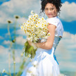 Stock Photo: Portrait of yang beautyful bride in chamomile field