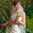 Smiling bride with bouquet — Foto de stock #8851952