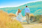 Happyness couple together walking in the field — Stock Photo