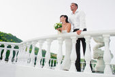 Happyness couple standing on the balcony isolated — Stock Photo