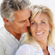 Happy mature couple smiling. - Stok fotoğraf