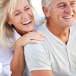 Happy mature couple laughing. — Stock Photo