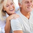 Stock Photo: Happy mature couple laughing.
