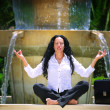 Stock Photo: Beautiful businesswompracticing yogoutdoors
