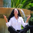 Beautiful businesswoman practicing yoga outdoors — Stockfoto