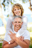 Mature couple smiling — Stok fotoğraf